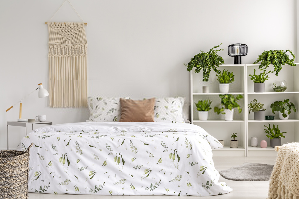 https://stock.adobe.com/images/close-to-nature-bright-bedroom-interior-with-many-green-plants-beside-a-big-bed-woven-tapestry-above-the-bed-real-photo/220243620